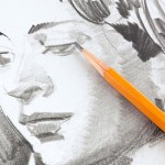 Drawing of face with pencil
